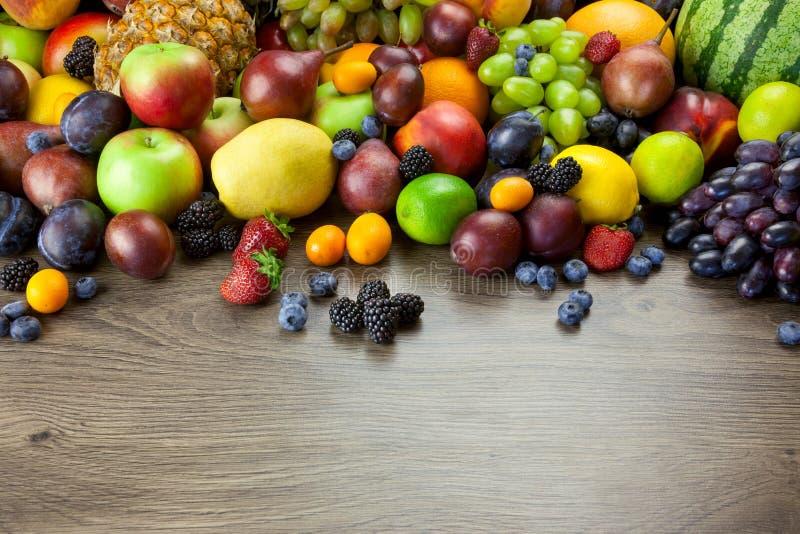 Big assortment of Fresh Organic Fruits, frame composition on woo stock photo