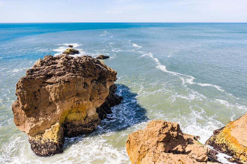 Big Atlantic ocean waves beat on rocks in Nazare, Portugal royalty free stock image