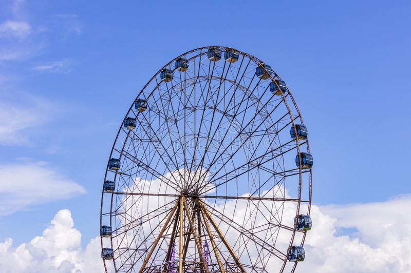 Big atraktsion ferris wheel on the background of a beautiful blue sky with clouds royalty free stock photos