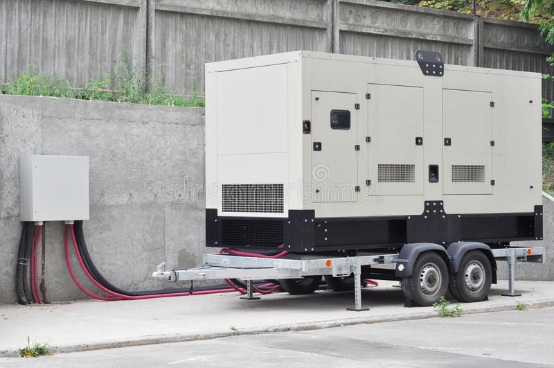 Big Backup Diesel Generator for Office Building Ð¡onnected to the the Control Panel with Cable Wire. Mobile Diesel Backup Generator for Office Building Ð¡ royalty free stock photo