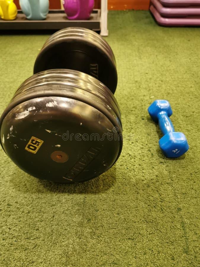 Big Bang Bang and small dumbbell. Weight stock photography