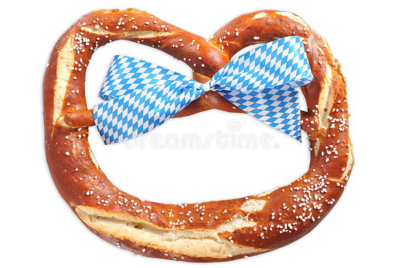 Big Bavarian Oktoberfest soft pretzel. Original big bavarian Oktoberfest soft pretzel with Bavarian flag from Germany on wooden board royalty free stock photos