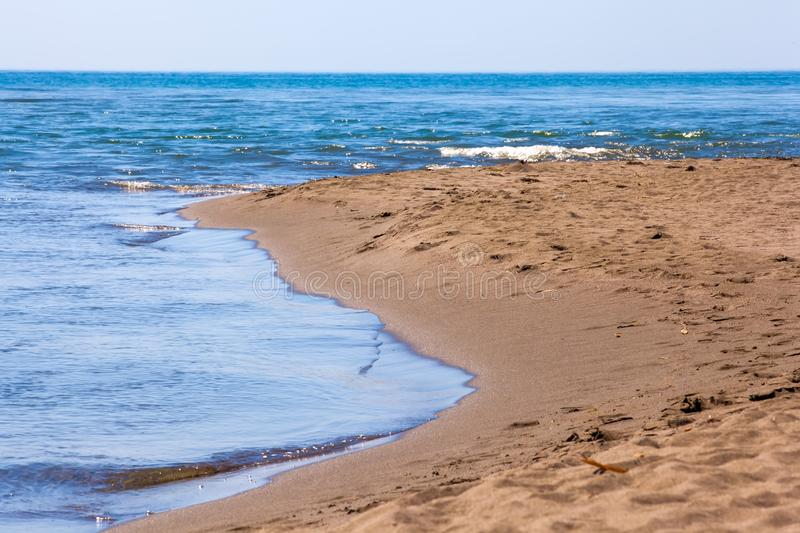 Beach on Ada Bojana, Ulcinj, Montenegro. Big beach with yellow sand on the shore at the confluence of the Buna River in the Adriatic Sea and Bojana Island is royalty free stock photos