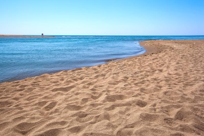 Beach on Ada Bojana, Ulcinj, Montenegro. Big beach with yellow sand on the shore at the confluence of the Buna River in the Adriatic Sea and Bojana Island is stock photo