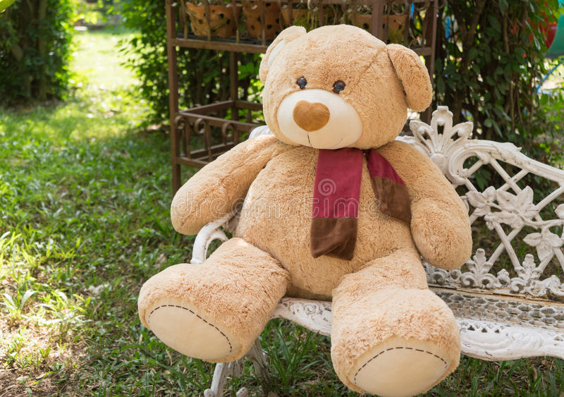 Big bear doll sit on the chair in garden stock photo image of download big bear doll sit on the chair in garden stock photo image of single publicscrutiny Choice Image