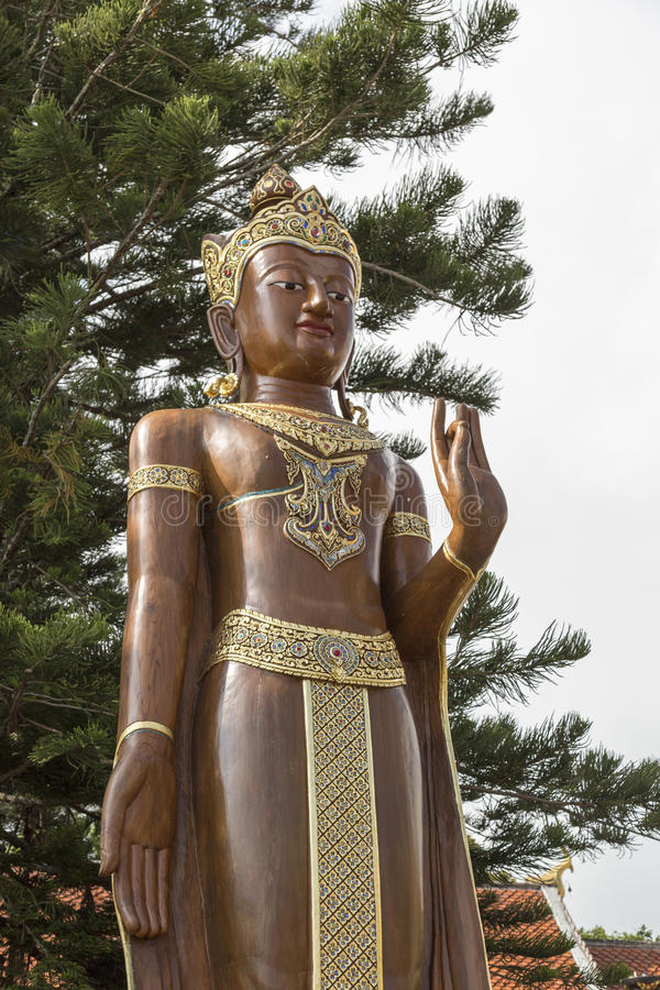 Big beautiful brown wooden Buddha. Located a top a hill in Wat Phra That Doi Suthep.Chiangmai, Thailand stock photography
