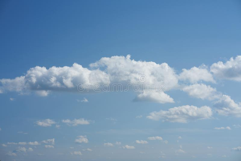 Big beautiful clouds in blue sky background stock photography