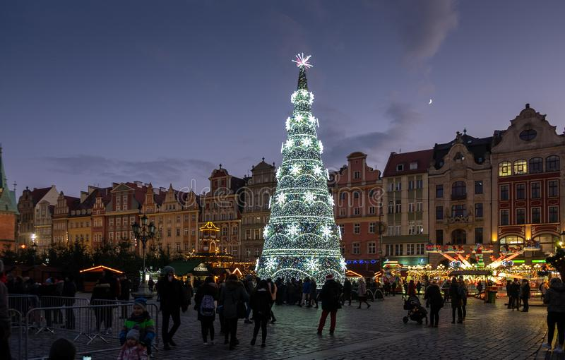 Big beautiful illuminated Christmas tree at Wroclaw city center. WROCLAW, POLAND - DECEMBER 12, 2019: Big beautiful illuminated Christmas tree at Wroclaw city royalty free stock image