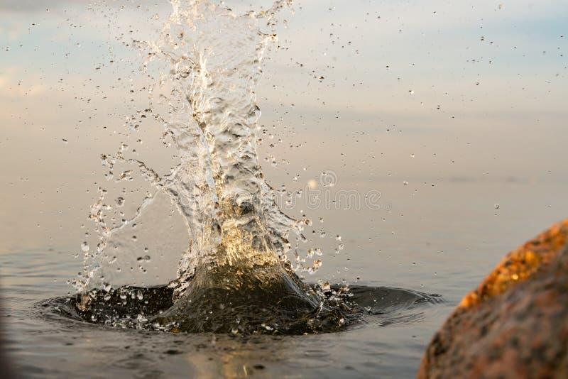 Big beautiful splash of water in the sea at sunset. natural desktop background. Beautiful splash of water in the sea at sunset. natural desktop background stock photography