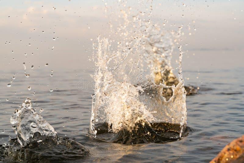 Big beautiful splash of water in the sea at sunset. natural desktop background. Beautiful splash of water in the sea at sunset. natural desktop background stock photos