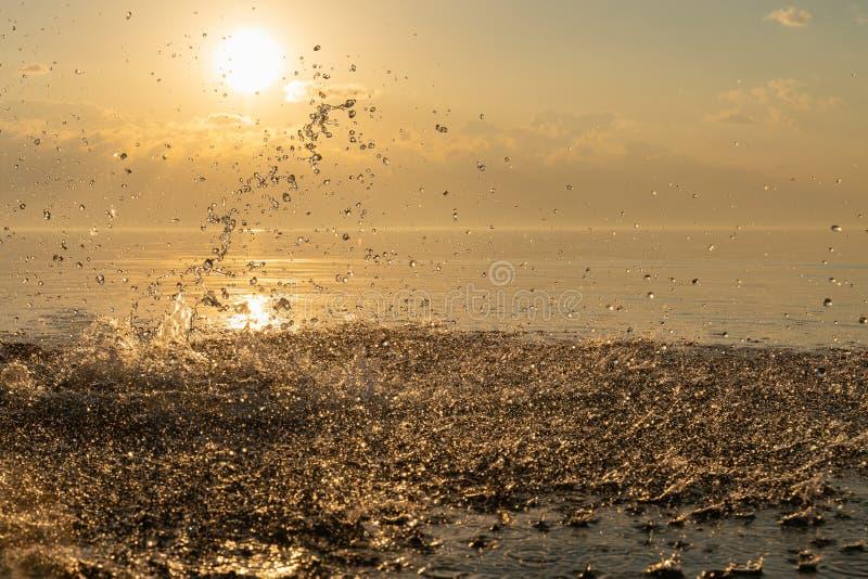 Big beautiful splash of water in the sea at sunset. natural desktop background. Beautiful splash of water in the sea at sunset. natural desktop background royalty free stock photo