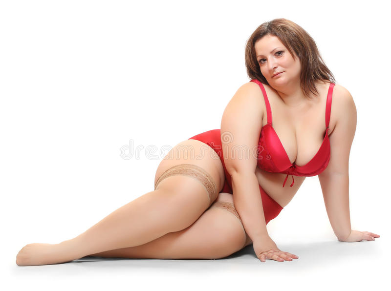 Big Beauty. Overweight woman dressed in retro underwear isolated on a white background stock photos