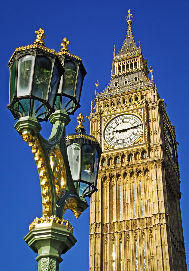 Big Ben. Seen from Westminster Bridge with an ornate lamp post in the foreground. Clear summer sky stock photography