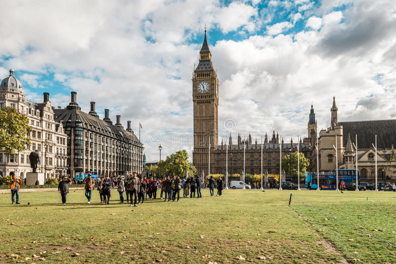 Big ben and city center of London, UK. London, United Kingdom - October 18, 2016: People are walking in London city ceter ner Big Ben in London, UK stock photography