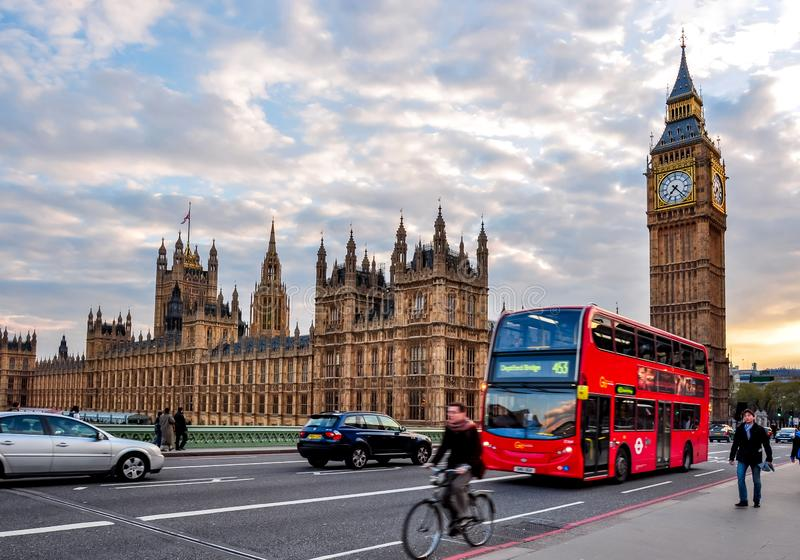 Big Ben and doubledecker bus on Westminster bridge at sunset, London, UK royalty free stock photo