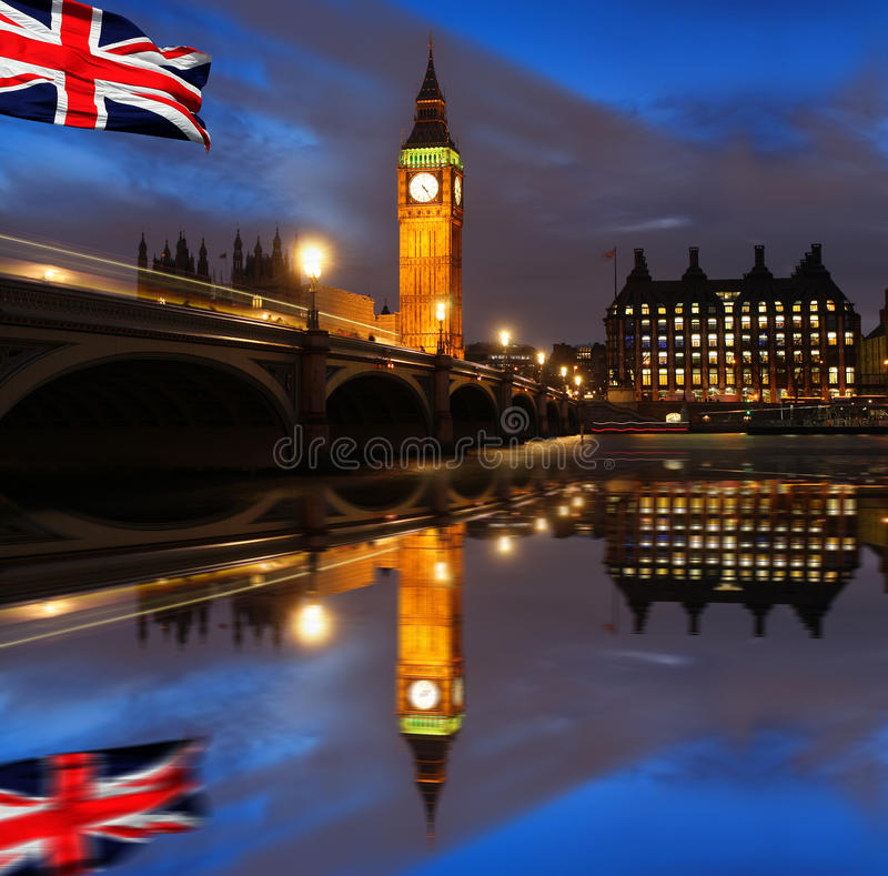 Big Ben in the evening, London, UK. Big Ben in the evening with flags of England, London, UK royalty free stock photos
