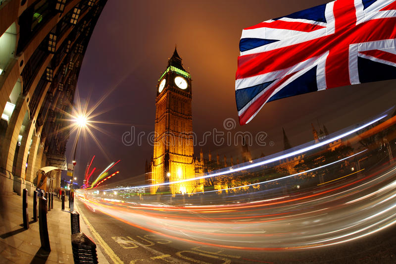 Big Ben in the evening, Westminster, London. Big Ben with flag of England in Westminster, London royalty free stock images