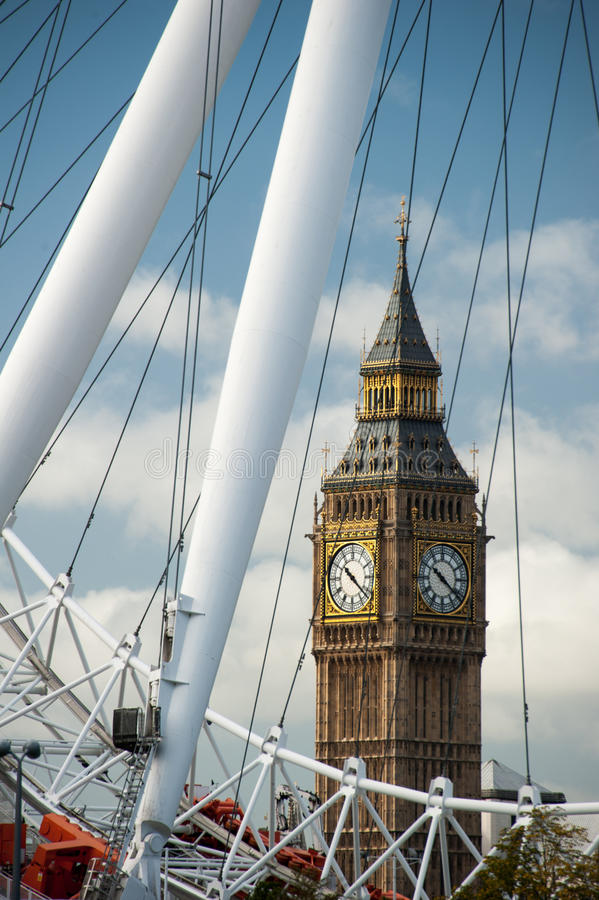 Big Ben through the Eye. A view of the Big Ben through the London Eye structure stock image