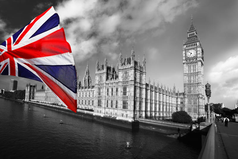Big Ben with flag, Westminster, London. Big Ben with colorful flag of England in Westminster, London royalty free stock images