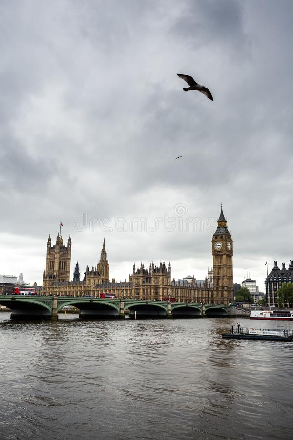 Big Ben and Houses of Parliament with boat in London, England, UK. stock image