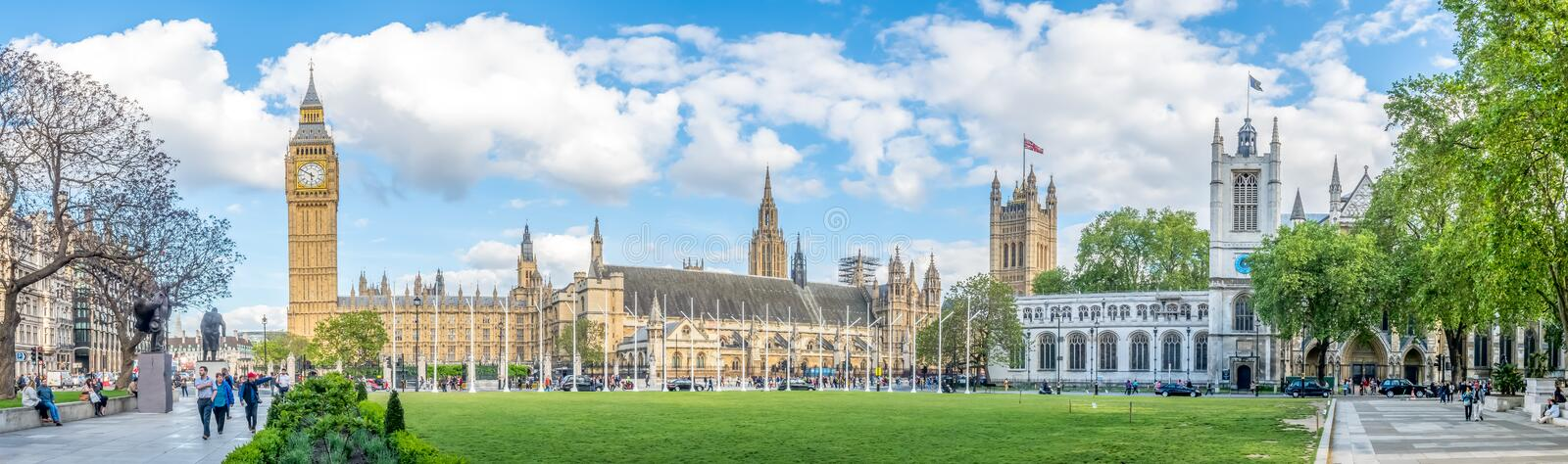 Big Ben from Paliament square garden in London. LONDON - MAY 24: Big Ben clock tower and Palace of Westminster view from Parliament square garden under cloudy stock photo