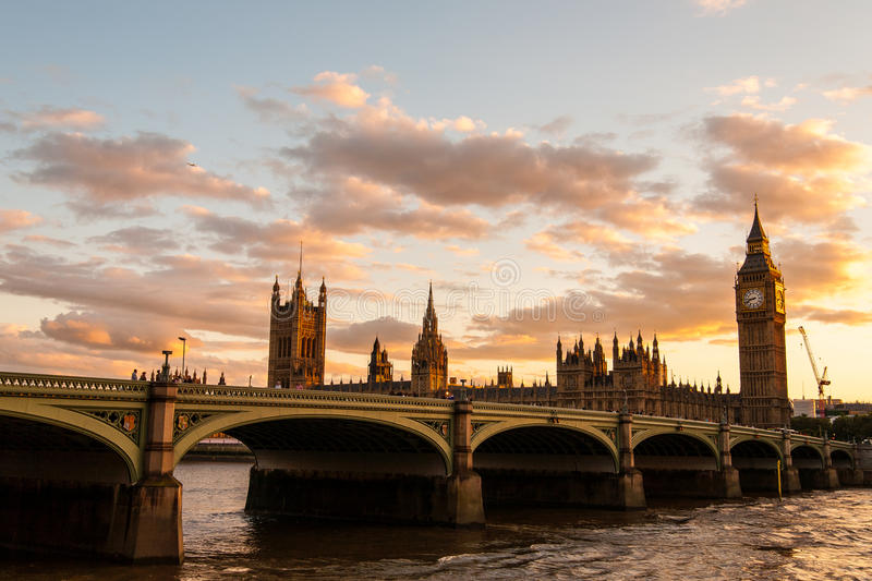 Big Ben with the Parliament at sunset in London. Golden Big Ben and Skyline stock image