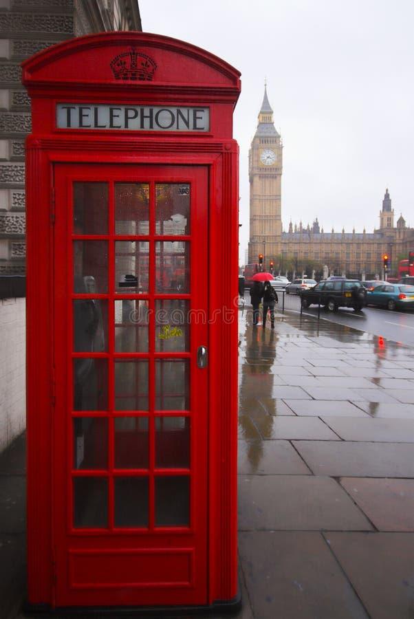 Big Ben Phone Box. Phone box and Big Ben on a rainy day, London England stock images