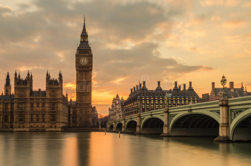 Big Ben at Sunset. Big Ben marking the time of sunset, a long exposure of the most beautiful building in London. I love the golden hue and how the clock tower is royalty free stock photos