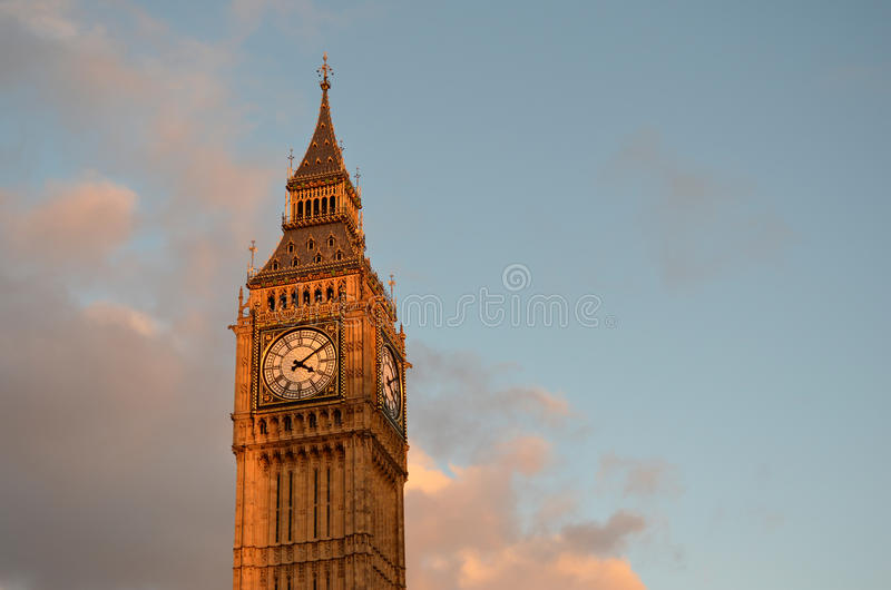 Big Ben tower with blue sky and some clouds stock photo