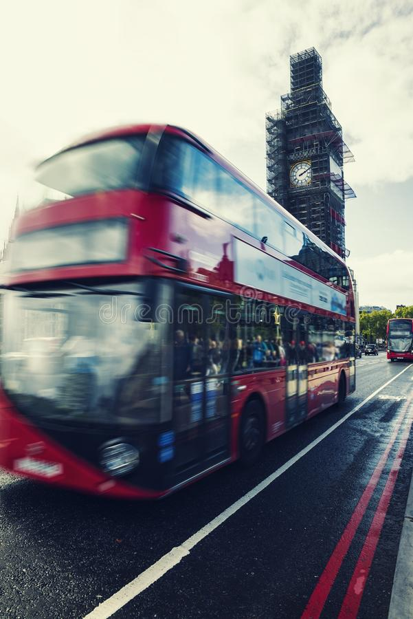 Big Ben Under Conservation Works and Red double decker bus in mo stock images