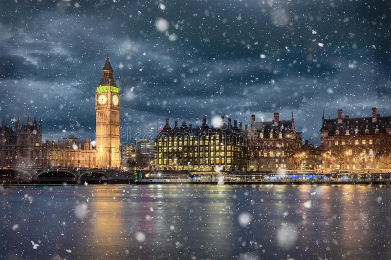 Big Ben and Westminster on a cold winter night. With falling snow, London, United Kingdom stock photo