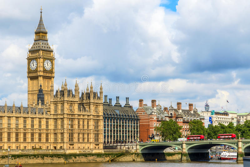 Big Ben and Westminster Palace. Against a cloudy sky royalty free stock images