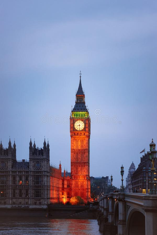 Big Ben at Westminster Palace and Thames River London evening. Big Ben at Westminster Palace in London old town in United Kingdom in evening. Thames River in royalty free stock photo