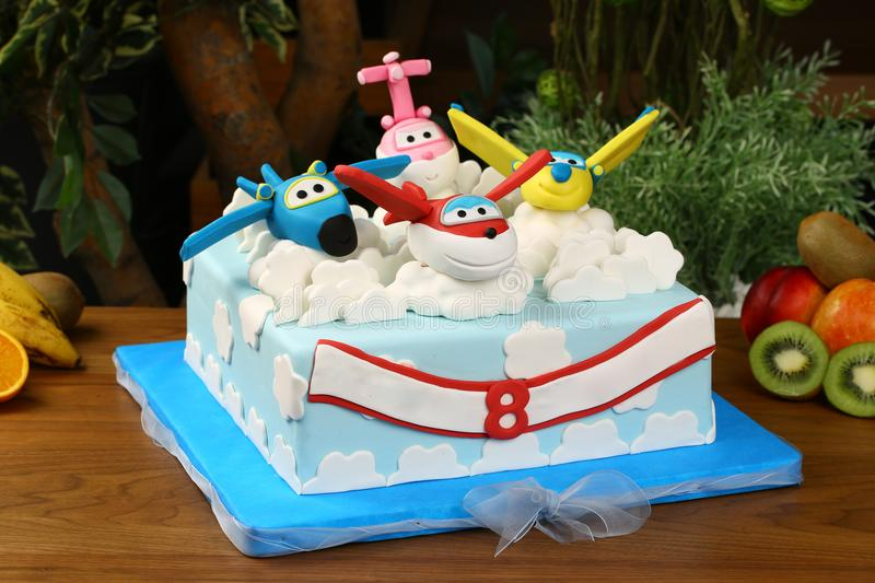 Kids birthday party cake - airplane consept. Big birthday cake decorated with airplane consept stock images