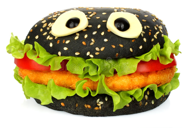 Big black funny hamburger whith cheese eyes. And chicken cutlet on white background royalty free stock image