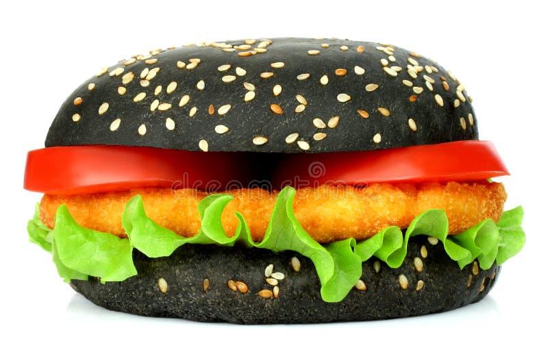 Big black hamburger with chicken cutlet royalty free stock photos