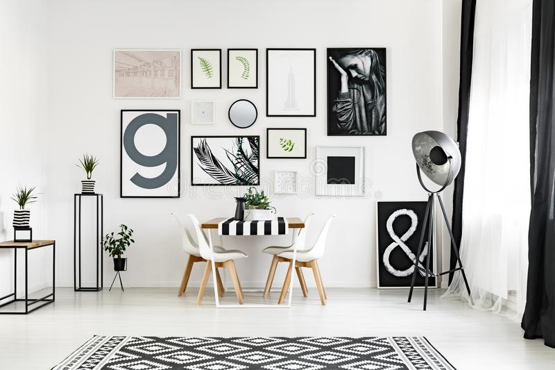 Carpet with geometric pattern. Big black and white carpet with geometric pattern in stylish living room royalty free stock photography