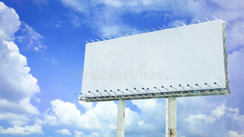 Big blank signboard poster on blue sky. Background with space use for texts or products display stock image