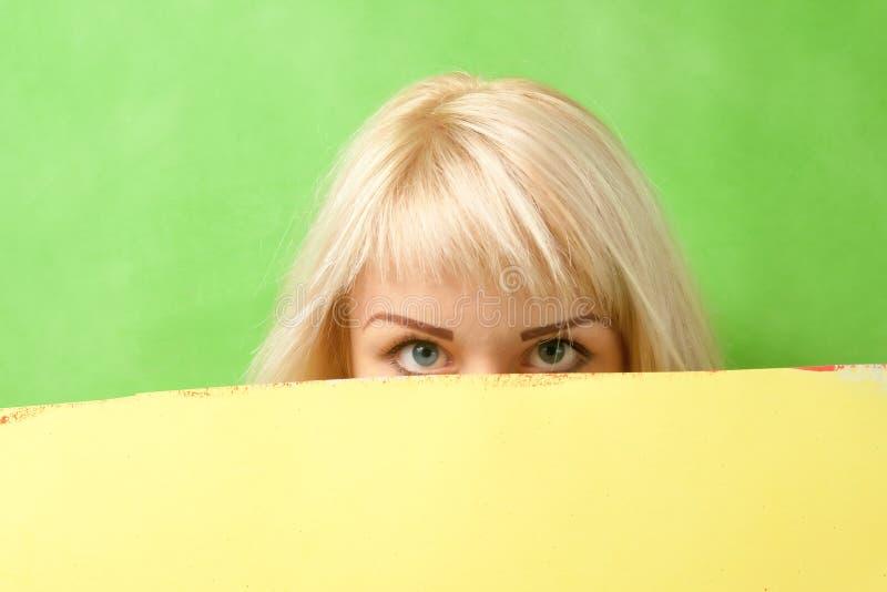 Big blue eyes of a beautiful girl stock photo