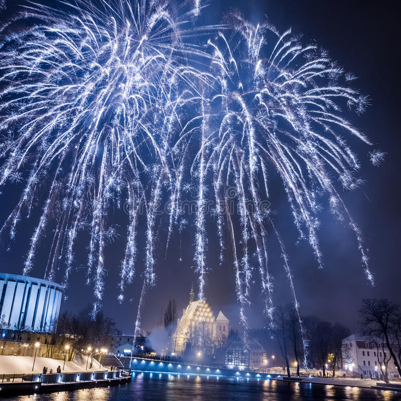 Big blue fireworks over the river royalty free stock photography