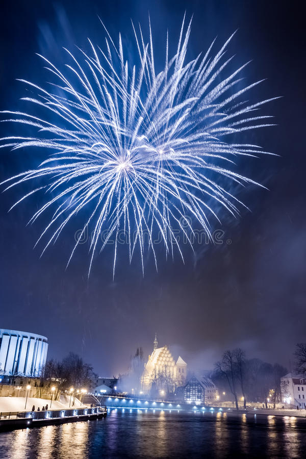 Big blue fireworks over the river royalty free stock photo