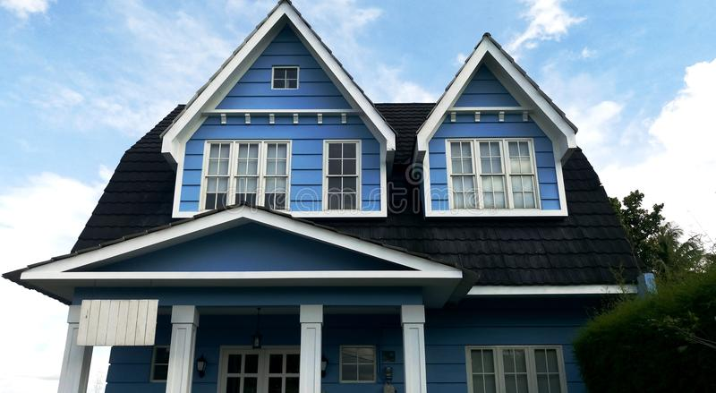 Big Blue Wood House in the village royalty free stock photo