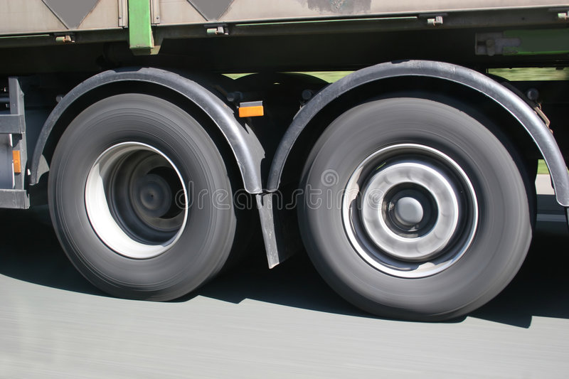 Big Blurred Lorry Wheels On The Move Stock Photos
