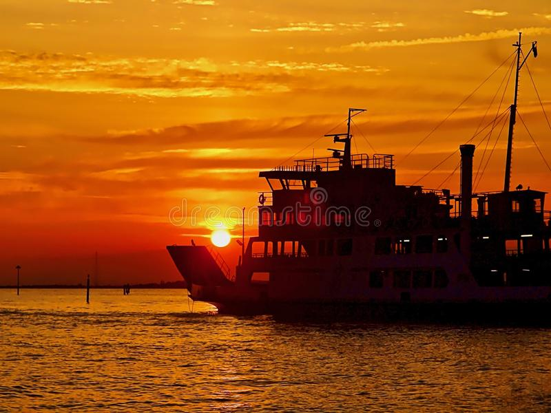 Big boat in Venice during sunset. Ship collects the sun in Venice during sunset royalty free stock images