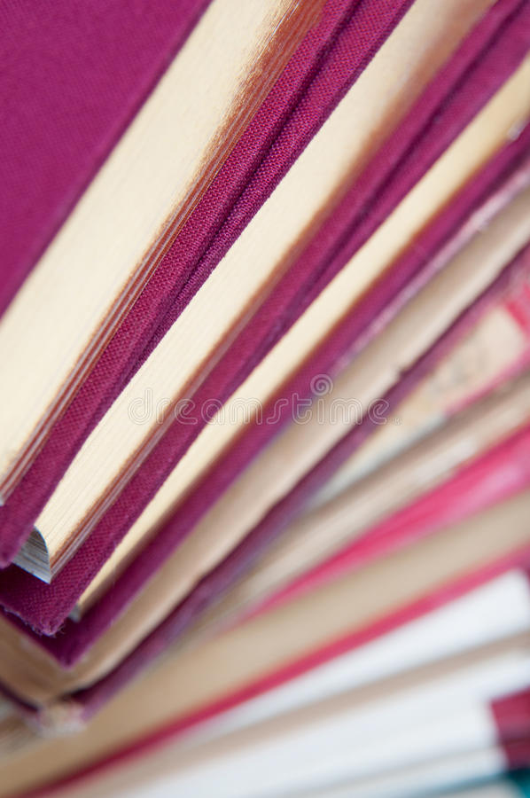 Big book pile. In spiral arrangement up view royalty free stock images