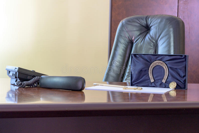 Big boss chair. In an office with table and furniture royalty free stock photos