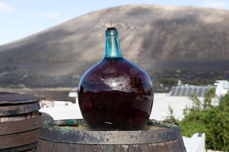 Big bottle with red grape wine. Lanzarote. Canary Islands stock image