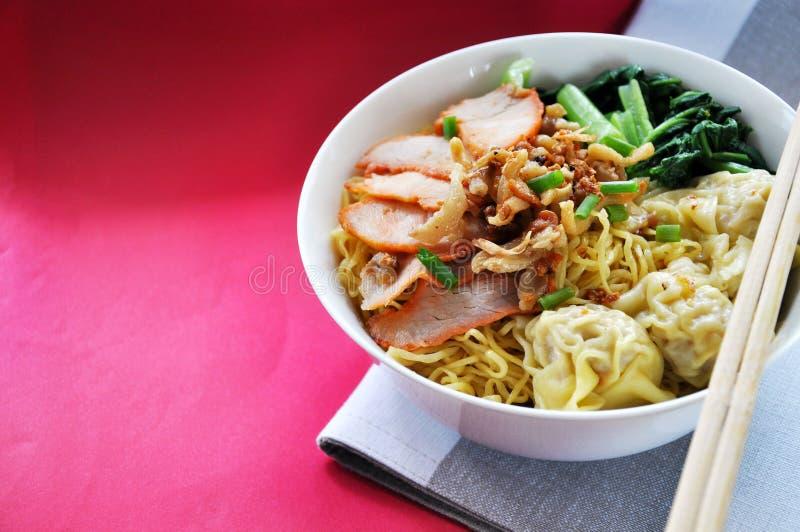 Big Bowl of Egg Noodles with Wonton and Sliced Pork stock photos