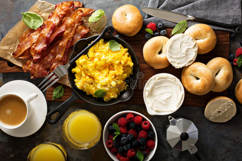 Big breakfast with bacon and scrambled eggs stock images