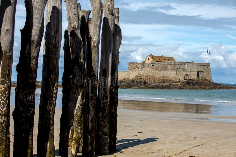 Big breakwater, 3000 trunks to defend the city from the tides, Plage de l`Éventail beach in Saint-Malo, Ille-et-Vilaine,. Brittany stock photography